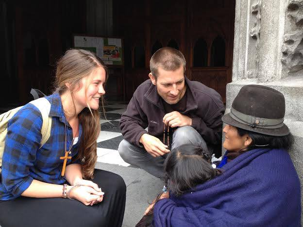 Missionaries Visit with poor woman in Quito, Ecuador