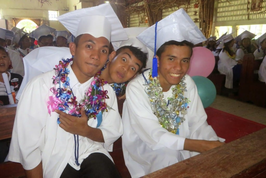 Melchoir (left) and his friends hamming it up at graduation.