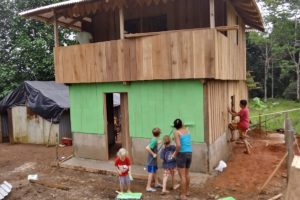 Herman and Sara helped build the new house, along with many others in the community coming together.