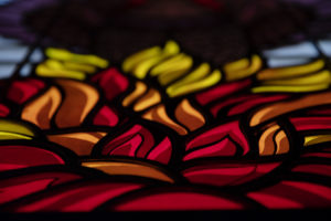 Imagery from St. Peter Church in Waldorf - stained glass window; red fire; Pentacost