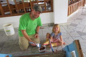 Jason and Aviana painting chapel pews