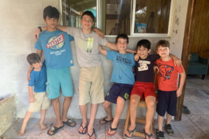 Zach, third from the left, with his siblings and friends